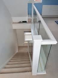 Two Flights of Glass banisters with primed Handrails