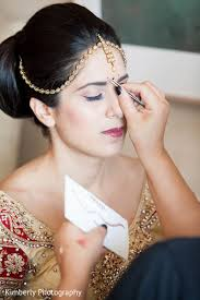 indian bride getting ready indian bridal hair and makeup indian weddings