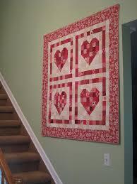 Heart Quilt. Get FREE quilt patterns now. http ... & Quilted wall hangings · Heart Quilt. Get FREE quilt patterns now.  http://onlinequiltingclassesmembership.ning Adamdwight.com