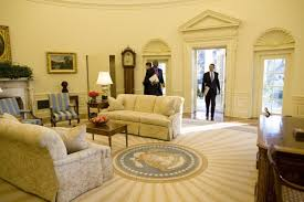 president oval office. President Barack Obama Entering The Oval Office In White House. Photograph By Pete Souza, 2009. Public Domain. E