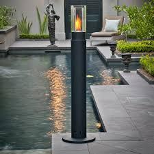 outdoor torch lighting. outdoor lighting design with black lit high pillar torch fire by brasa h