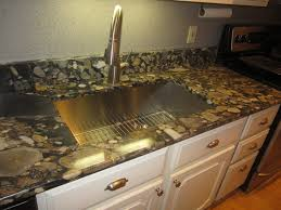 black marinace gold the placement of the template is key even the back splash cut from the adjacent top is critical to the flow of the piece