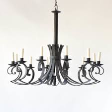 vintage spanish iron chandelier with simple arm design and central orb
