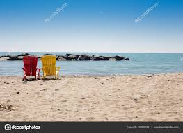 adirondack chairs on beach. Beach Scene With Two Colorful Adirondack Chairs \u2014 Stock Photo On