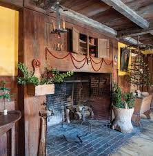 cranberries strung on thread festoon the old kitchen fireplace a feather tree with miniature ornaments