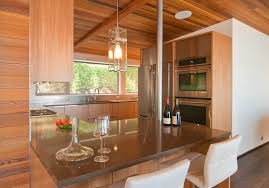 kitchen mid century modern kitchen remodel recessed ceiling light brass hanging chandeliers wooden glass wall
