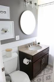 bathroom update a beautiful gray color on the walls really makes the white shiplap walls pop
