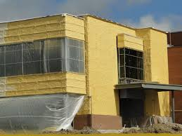 exterior spray foam sealant. medium-density closed cell spray foam insulation has been applied outside of the sheathing on this building to form a continuous layer that exterior sealant t