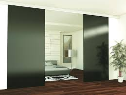 sliding door system featuring dn80 sliding hardware in a barn door af010 frame in black finish and black matte backpainted glass inserts