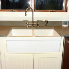 what is a farmhouse sink unique farmhouse sink with drainboard and backsplash high back white