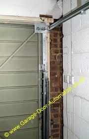 henderson garage doorRehanging a double width vertically tracked door