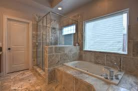 recessed lighting over shower. above shower bathroom window with built in bathtub and marble tile also recessed lights lighting over l
