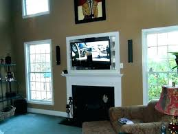 mounting tv above brick fireplace above fireplace hiding wires hang above fireplace mounting above gas fireplace