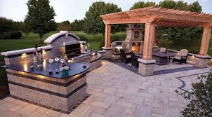 outdoor living space with kitchen patio fireplace