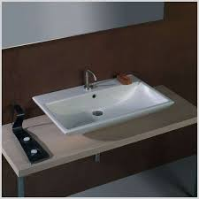 rumors lies and undermount trough bathroom sink with two faucets
