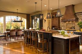 country tuscan kitchen decor with multi pendant lamps above small marble countertop kitchen island and