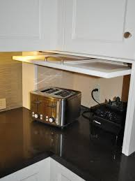 cote kitchen with white cabinets pot filler centophobe