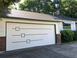 Mid century modern garage door Residential Garage Door That Combines Midcentury Modern Style And 21st Century Functionality The New Door Can Be Opened And Closed Via Cell Phone Retro Renovation Midcentury Modern Garage Door Made New For Nanette Retro