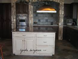 white kitchen cabinets to a hand painted stained wood look and white distressed kitchen island