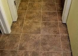 self adhesive vinyl tiles on floor putting tile over in bathroom cover cork flooring kitchen