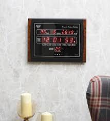 black plastic digital wall clock by