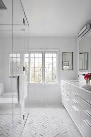 spacious all white bathroom. All-white Counters, Floors And Walls Create An Open Airy Feel In This Spacious All White Bathroom