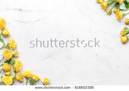 marble table top background. spring concept with flowers on white marble table background top view mockup