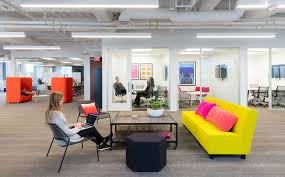 inspiring office spaces. The Space Is Mostly Made Up Of Benching Stations, With Offices Located Along Interior Building, Preserving Natural Light Exterior For Inspiring Office Spaces