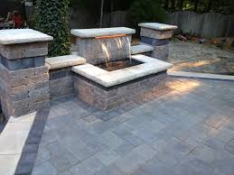 raised patio pavers. Fire Pit Bricks Luxury Beautiful Waterfall And Raised Patio Using Unilock Brick Pavers K