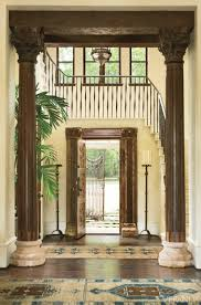 foyer rugs are two blue oriental rugs in traditional entryway of dallas home designed by michelle