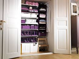 lovely purple details closet organizing ideas in big wall with big two door on