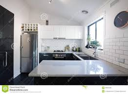 New Black And White Contemporary Kitchen With Subway Tiles Stock - White contemporary kitchen