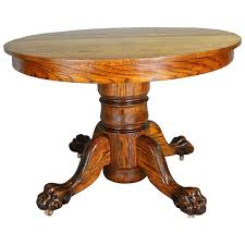 antique claw foot round oak dining table