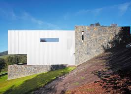 villa in the beskydy mountains is clad in a 3d perforated sheet metal facade