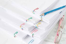 Paper Reports Pencil Put On Stack Of Overload Paper And Reports With Spectacles