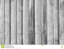 Legno Bianco Nero : Vecchia struttura di legno in bianco e nero del recinto fotografia