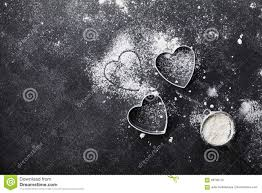 black table top view. royalty-free stock photo. download baking background with flour and heart shape on kitchen black table top view for valentines