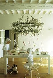 Christmas Tea under an olive branch decorated candelabra. Photo by Frederic  Vasseur/The Interior