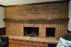 dark living room brick wall with a fireplace from 1980s home