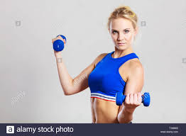Lifting Light Weights Sporty Woman Lifting Light Dumbbells Weights Fit Girl