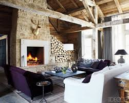 amazing country style living room with white sofa and purple velvet sofa blue coffee table and friepalce also with firewood image