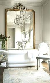 chandelier above bathtub an oversized vintage frame mirror and a large crystal chandelier over the tub chandelier above bathtub