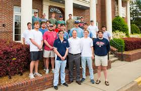 david magee front center visits with members of um chapter of sigma nu fraternity including front from left philanthropy co chair nick egorshin of