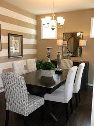 traditional dining room with a striped accent wall these colors want to incorporate gold cream brown