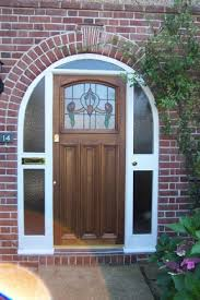 arched front door1930s Arched door with real leaded glass 2552  Porch