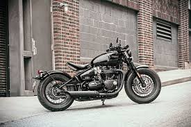 triumph pulls off a double with bobber black and speedmaster