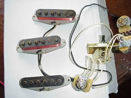fender custom 65 single coil strat pickups for stratocasters demo note diorrecne in copper colored wire on cs 60s left and cs 65 pickups right