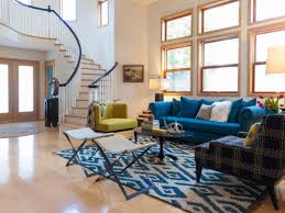 blue sofas living room: contemporary living room with blue sofa green chair and staircase