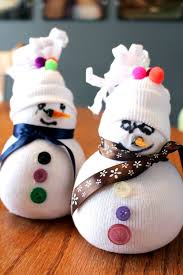 a snowman made from rice and a sock is a simple and perfect craft for a