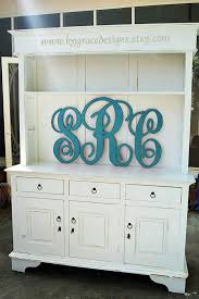 hand cut and painted set of monogram letters in blue and white so adpi